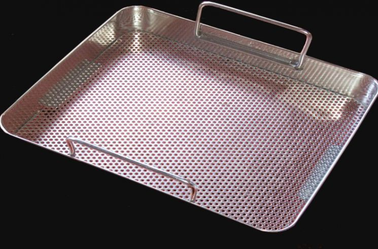 Perforated tray for medical use.