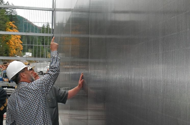 Hendrick inspects a fish screen after installation