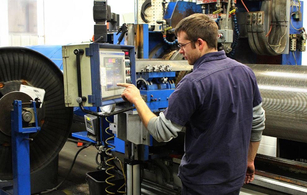 Hendrick Employee Operating Manufacturing Equipment